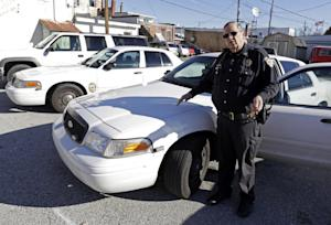 In this Nov. 14, 2013 photo, Knightstown Police Chief …