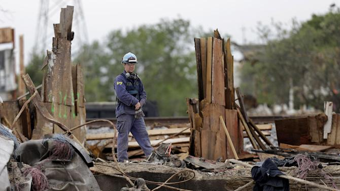 An investigator looks over a destroyed fertilizer plant in West, Texas, Thursday, May 2, 2013. Investigators face a slew of challenges in figuring out what caused the explosion at the fertilizer plant that killed 14 people and destroyed part of the small Texas town. (AP Photo/LM Otero, Pool)