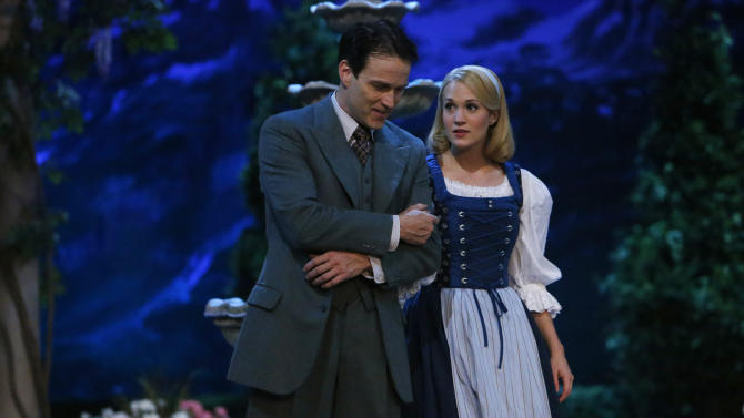 "This photo provided by NBC shows Stephen Moyer, left, as Captain Von Trapp and Carrie Underwood as Maria, in ""The Sound of Music Live!"" airing Thursday, December 5, 2013, on NBC (8-11 p.m. ET). (AP Photo/NBC, Will Hart)"