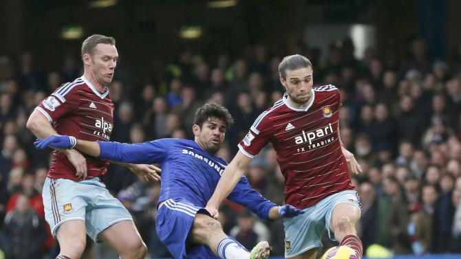Chelsea's Diego Costa is challenged West Ham United's Kevin Nolan and Andy Carroll during their English Premier League soccer match at Stamford Bridge in London