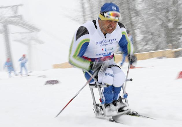 Fernando Rocha of Brazil races during the qualification round of the men's cross country 1km sprint, sitting event at the 2014 Winter Paralympic, Wednesday, March 12, 2014, in Krasnaya Polyana, Ru