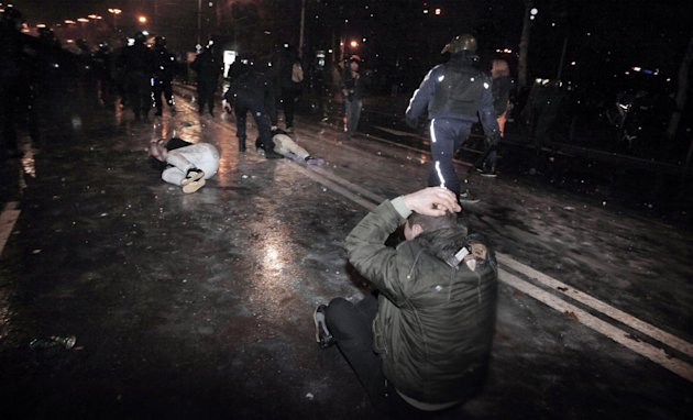 Protesters are detained by the riot police during a protest against high electricity prices in Sofia, on late Tuesday, Feb. 19, 2013.  Bulgaria's prime minister announced on Tuesday that the license h