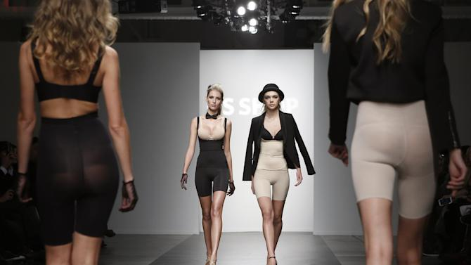 CAPTION CORRECTION, CORRECTS TO REMOVE REFERENCE TO ANNA SUI, WHOSE COLLECTION WAS NOT REPRESENTED AT THIS SHOW - Models walk the runway during the presentation of the GS Shop Lingerie show featuring Spanx, Wonderbra, and Platex during Fashion Week Tuesday, Feb. 4, 2014, in New York. (AP Photo/Kathy Willens)