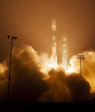 CLICK IMAGE for slideshow: In this image released by NASA, a Delta 2 rocket with the Orbiting Carbon Observatory-2 satellite launches at Vandenberg Ai...