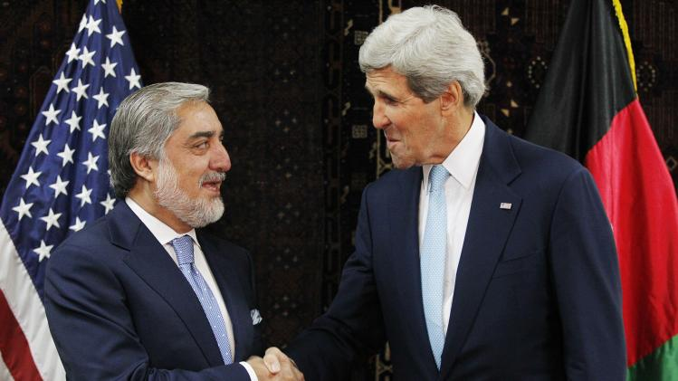 Afghanistan's presidential candidate Abdullah shakes hands with U.S. Secretary of State Kerry at the start of a meeting at the U.S. embassy in Kabul