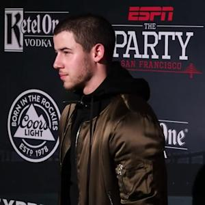 EXCLUSIVE: Watch Nick Jonas Adorably Avoid Addressing Dating Rumors With Lily Collins