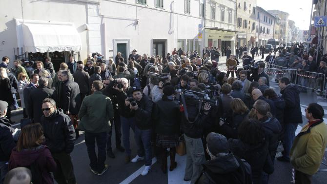 People gather outside the Moderno theater in Grosseto, Italy, Saturday, March 3, 2012 for the Costa Concordia shipwreck initial evidence hearing. The Italian prosecutor for the investigation of the Costa Concordia shipwreck says it could take experts three months to analyze the cruise ship's voice recorder. Prosecutor Francesco Verusio spoke to state radio as hundreds of lawyers, consultants, former passengers and crew arrived in Grosseto, Tuscany, Saturday for the initial evidence hearing. There are so many participants at the closed-door hearing that a local theater is being used. (AP Photo/Luca Bruno)