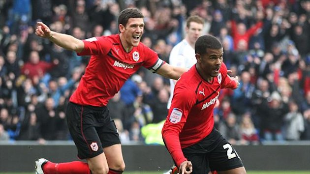 Fraizer Campbell, right, wearing Cardiff's red kit