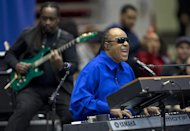 FILE - In this Nov. 4, 2012 file photo, Stevie Wonder performs at a campaign event for President Barack Obama at the Fifth Third Arena on the University of Cincinnati campus in Cincinnati. Wonder is not excited about the use of Lil Wayne&#39;s vulgar lyrics that reference Emmett Till, a black teen who was killed in 1955 for allegedly whistling at a white woman. The R&B legend says the rapper&#39;s disturbing verse should not have made it beyond the recording studio for the world to hear.(AP Photo/Carolyn Kaster)