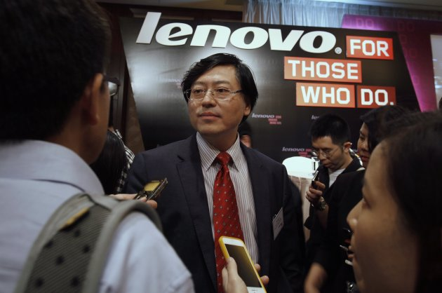 Lenovo Chairman and CEO Yang is surrounded by journalists during a news conference on the company's annual results in Hong Kong