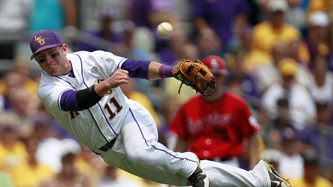 LSU third baseman Tyler Hanover tries to throw out Stony Brook's Maxx Tissenbaum at first base during the third inning of an NCAA college baseball tournament super regional game in Baton Rouge, La., Friday, June 8, 2012.  Tissenbaum was safe at first. (AP Photo/Gerald Herbert)