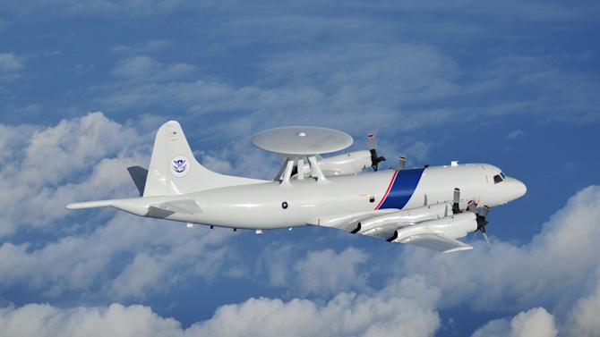 In this undated photo released by the U.S. Customs and Border Protection on Jan. 31, 2013, a P3 Orion Airborne Early Warning aircraft belonging to the CBP flies at an unspecified location. The Central American country abolished its army in 1948 and plowed money into education, social benefits and environmental preservation. As a result, Costa Rican officials say, the country can't battle ruthless and well-equipped Mexican drug cartels without U.S. help. The U.S. is patrolling Costa Rica's skies and waters and providing millions of dollars in training and equipment to Costa Rican officials who have launched a tough line on crime backed by top-to-bottom transformation of the law-enforcement and justice systems. (AP Photo/U.S. Customs and Border Protection)