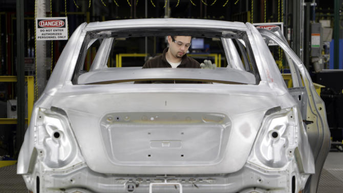 In this May 19, 2011 photo, line worker Dave Zamora works on a pre-production Chevrolet Sonic at the General Motors Orion Assembly plant in Orion Township, Mich. A private trade group says that manufacturing activity in June recovered somewhat from a sharp slowdown in May.(AP Photo/Paul Sancya)