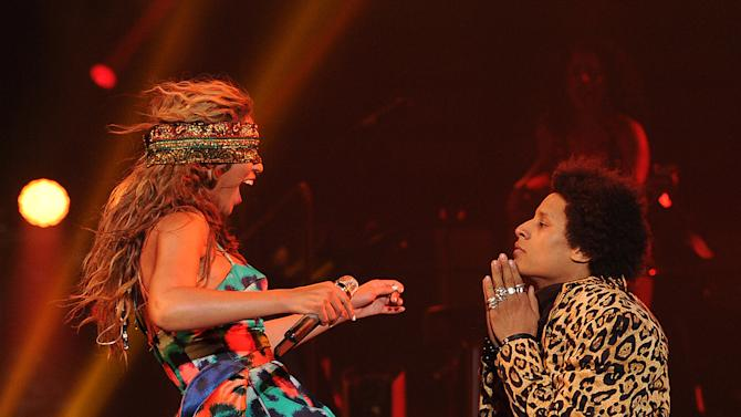 """Singer Beyonce performs the song """"Grown Woman"""" with dancer Laurent Bourgeois on her """"Mrs. Carter Show World Tour 2013"""", on Wednesday, April 24, 2013 at the Palais Omni Sport Bercy in Paris, France. Beyonce is wearing a custom printed romper with bustle by designer Kenzo. (Photo by Frank Micelotta/Invision for Parkwood Entertainment/AP Images."""