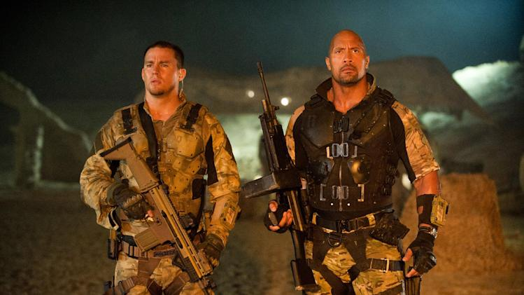 "FILE - In this publicity film image released by Paramount Pictures, Channing Tatum, left, and Dwayne Johnson are shown in a scene from ""G.I. Joe: Retaliation."" In ""Retaliation,"" Johnson takes over for Tatum, the star of 2009's ""G.I. Joe: The Rise of Cobra."" Tatum plays a smaller role in the sequel as Johnson introduces moviegoers to Roadblock, a character from the G.I. Joe universe who's built like a tank but always served second in command. (AP Photo/Paramount Pictures, Jaimie Trueblood, File)"