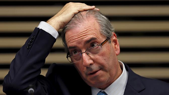 "President of the Chamber of Deputies Eduardo Cunha reacts at the event ""More Women in Politics"" in Sao Paulo"