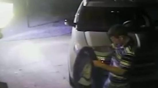 Burglar caught on tape during car break-in