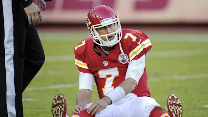 Kansas City Chiefs quarterback Matt Cassel (7) adjusts his sox after getting knocked to the ground during the second half of an NFL football game against the Oakland Raiders at Arrowhead Stadium in Kansas City, Mo., Sunday, Oct. 28, 2012. (AP Photo/Reed Hoffmann)