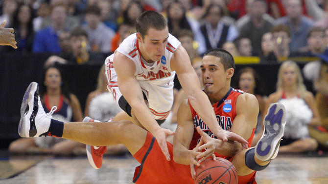 Ohio State guard Aaron Craft, left, and Arizona guard Nick Johnson scramble for the ball during the second half of a West Regional semifinal in the NCAA men's college basketball tournament, Thursday, March 28, 2013, in Los Angeles. Ohio State won 73-70. (AP Photo/Mark J. Terrill)