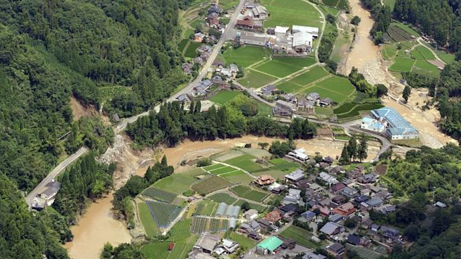 Floods in Japan kill 26, thousands remain cut off