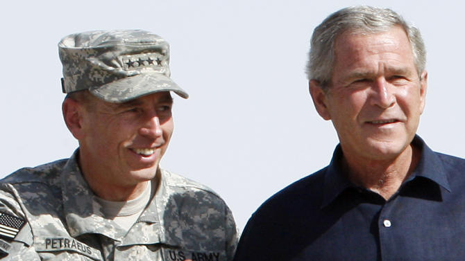 FILE - In this Sept. 3, 2007 file photo, then-President George W. Bush, right, stands with Gen. David Petraeus as he arrives for a surprise visit at Al-Asad Airbase in Anbar province, Iraq. Petraeus, the retired four-star general who led the U.S. military campaigns in Iraq and Afghanistan, resigned Friday, Nov. 9, 2012 as director of the CIA after admitting he had an extramarital affair. (AP Photo/Charles Dharapak, File)