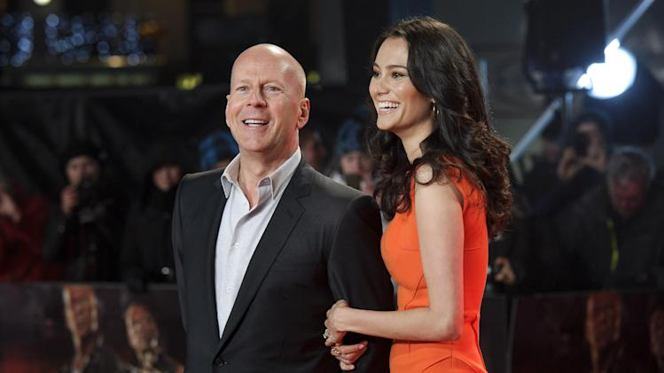 "FILE - In this Thursday, Feb. 7, 2013 file photo, U.S. actor Bruce Willis, left, and British actress Emma Heming arrive for the British premiere of  the film, ""A Good Day To Die Hard,"" at a central London cinema. (Photo by Jonathan Short/Invision/AP, File)"