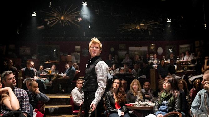 """This undated theater image released by The Hartman Group shows Lucas Steele in """"Natasha, Pierre and the Great Comet of 1812,"""" a dinner theater performance that opened Thursday, May 15, 2013 in the meatpacking district of New York. (AP Photo/The Hartman Group, Chad Batka)"""