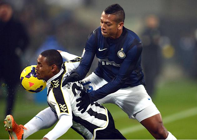 Inter Milan's Fredy Guarin, right, pushes Udinese's Antunes Da Silva as they go for the ball during an Italian Cup soccer match at the Friuli Stadium in Udine, Italy, Thursday, Jan. 9, 2014