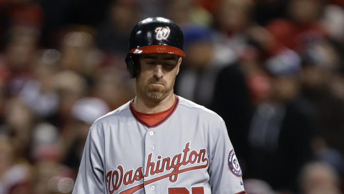 Washington Nationals' Adam LaRoche stands at the plate after taking a called third strike in the fourth inning of a baseball game against the Cincinnati Reds, Friday, April 5, 2013, in Cincinnati. (AP Photo/Al Behrman)
