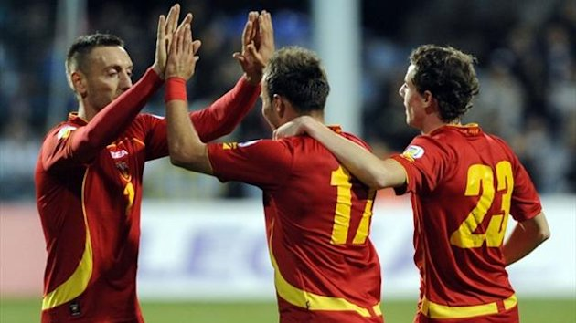 Montenegro's Elsad Zverotic (C) is congratulated by teammates