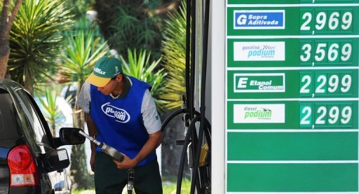 <p>A gas station worker fills the tank of a car in Rio de Janeiro in 2011. Brazilian inflation slowed in June to its lowest level in nearly two years thanks to temporary tax cuts on vehicles and lower fuel prices as the government seeks to boost the economy.</p>