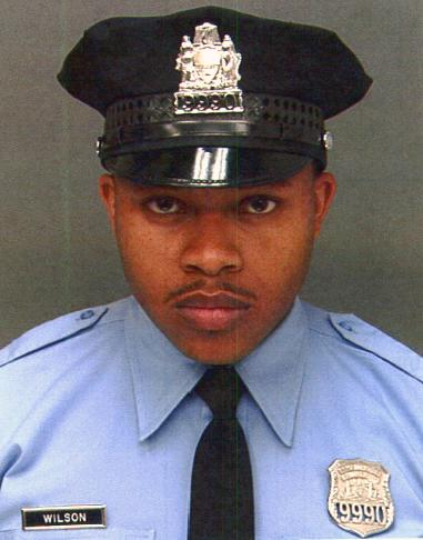 Philadelphia police mourn officer killed during robbery