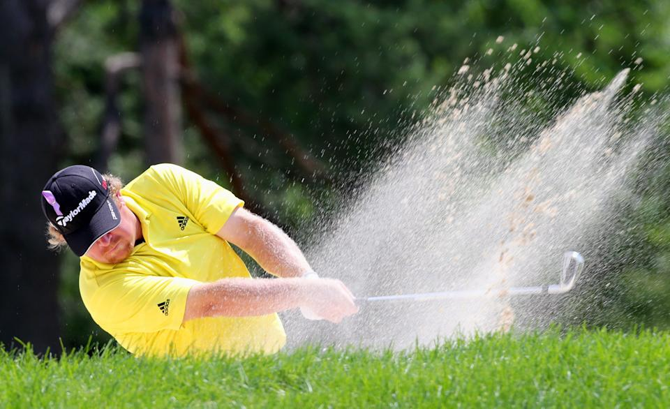 William McGirt hits from a bunker on the first hole during the third round of the Canadian Open golf tournament, Saturday, July 28, 2012, in Ancaster, Ontario. (AP Photo/The Canadian Press, Dave Chidley)