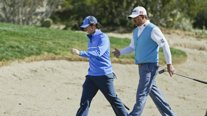 Rory McIlroy, left, and Graeme McDowell walk along the 10th fairway while playing a practice round for the Match Play Golf Championship tournament, Tuesday, Feb. 19, 2013, in Marana, Ariz. (AP Photo/Julie Jacobson)
