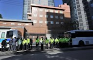 File photo shows policemen standing guard outside the Japanese embassy in Seoul in October 2011. A South Korean rammed his light truck into the main gate of Japan's embassy in Seoul early Monday in protest at an earlier demonstration in the city by a rightwing Japanese activist, police said