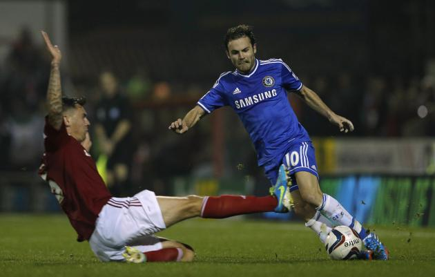 Swindon Town's Hall fouls Chelsea's Mata during their English League Cup soccer match at the County Ground in Swindon