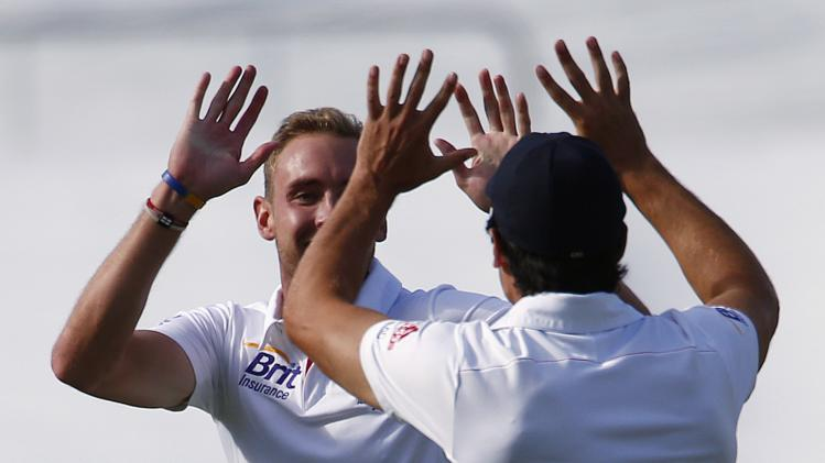 England's Stuart Broad celebrates with captain Cook after dismissing Australia's Bailey for 53 runs during the first day's play in the second Ashes cricket test at the Adelaide Oval