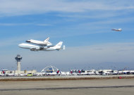 NASA's space shuttle Endeavour flies over Los Angeles International Airport while riding piggyback atop its Shuttle Carrier Aircraft on Sept. 21, 2012, during a4.5-hour aerial tour over California. The shuttle was being delivered to L.A., where