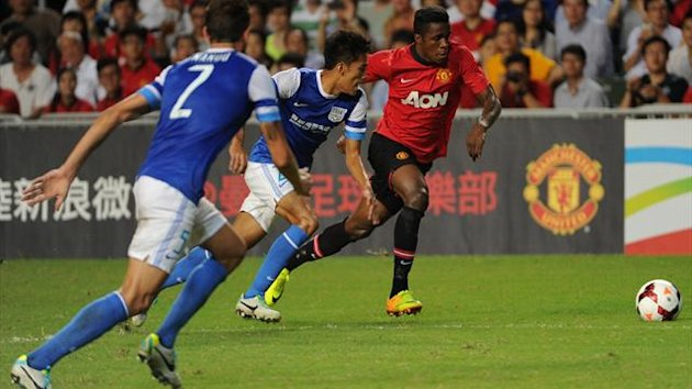 Manchester United's Wilfried Zaha (R) controls the ball against Kitchee during their football friendly match at Hong Kong stadium (AFP)