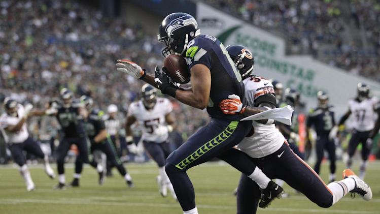 Seattle Seahawks' Jermaine Kearse, left, hauls in a 12-yard touchdown pass as Chicago Bears' Charles Tillman defends in the first half of a preseason NFL football game, Friday, Aug. 22, 2014, in Seattle