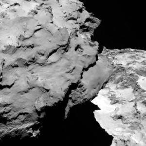 Close-up detail of comet 67P/Churyumov-Gerasimenko. The image was taken by Rosetta's OSIRIS narrow-angle camera and downloaded Wednesday, Aug. 6, 2014. The image shows the comet's 'head' at the left of the frame, which is casting shadow onto the 'neck' and 'body' to the right. The image was taken from a distance of 120 km and the image resolution is 2.2 meters per pixel. A mission to land the first space probe on a comet reaches a major milestone when the unmanned Rosetta spacecraft finally catches up with its quarry on Wednesday. It's a hotly anticipated rendezvous: Rosetta flew into space more than a decade ago and had to perform a series of complex maneuvers to gain enough speed to chase down the comet on its orbit around the sun. (AP Photo/ESA/Rosetta/MPS for OSIRIS Team )