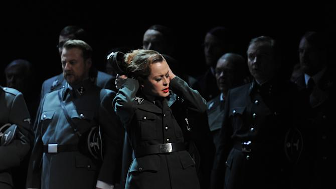 """The photo provided by Deutsche Oper am Rhein in Duesseldorf, western Germany, shows  Elena Zhidkova as Venus in front of the choir in a scene of the the opera 'Tannhaeuser' during the dress rehearsal on April 30, 2013.  The modern production of Richard Wagner's opera Tannhauser has caused a stir in Germany because of Nazi-themed scenes showing people dying in gas chambers and a family getting their heads shaved and executed. A spokeswoman for the Duesseldorf opera house said Tuesday that members of the audience """"booed and were shocked"""" by Saturday's, May 3, 2013 opening performance. (AP Photo/Deutsche Oper am Rhein, Hans Joerg Michel) Mandatory Credit"""