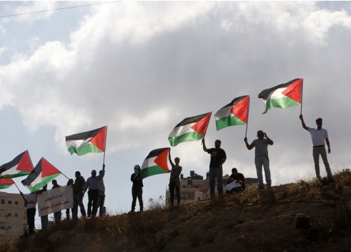Activists protest at the entrance to the West Bank Jewish settlement of Maale Adumim near Jerusalem, to show solidarity with Palestinian prisoners held in Israeli jails
