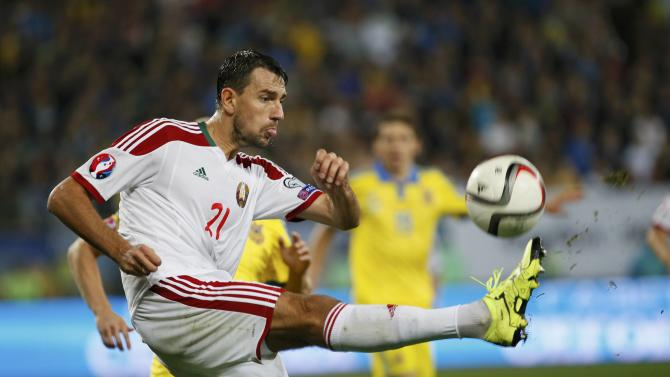 Belarus' Filipenko kicks ball during their Euro 2016 group C qualification match against Ukraine at Arena Lviv stadium in Lviv