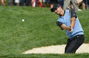 Adam Scott of Australia hits from the sand on the 14th hole during his match against Bill Haas of the U.S. during the Singles matches for the 2013 Presidents Cup golf tournament at Muirfield Village Golf Club in Dublin