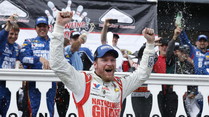 FILE - In this Aug. 3, 2014 file photo, Dale Earnhardt Jr. celebrates in Victory Lane after winning the NASCAR Sprint Cup Series auto race at Pocono Raceway in Long Pond, Pa. The National Guard is ending its sponsorship of both NASCAR's most popular driver and one of the most recognizable names in IndyCar. It's not clear when the guard is leaving motorsports. It said in a Wednesday, Aug. 6, 2014, statement on its web site that its contracts to sponsor Dale Earnhardt Jr. in NASCAR and Graham Rahal in IndyCar run through the end of the year. (AP Photo/Matt Slocum, File)