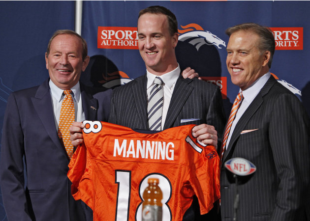 New Denver Broncos quarterback Peyton Manning, center, is flanked by Broncos owner Pat Bowlen, left, and vice president John Elway during a news conference at the NFL Denver Broncos headquarters in En