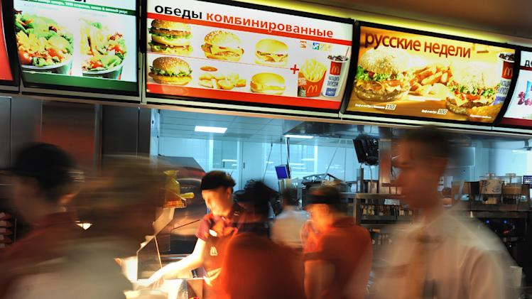 Employees serve clients in a McDonald's restaurant on Pushkin square in Moscow on February 1, 2010