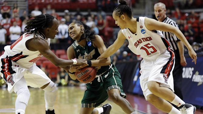 South Florida guard Andrell Smith, center, fights to keep the ball from Texas Tech guards Chynna Brown, left, and Casey Morris (15) during the second half of a first-round game in the women's NCAA college basketball tournament in Lubbock, Texas, Saturday, March 23, 2013. South Florida won 71-70. (AP Photo/LM Otero)