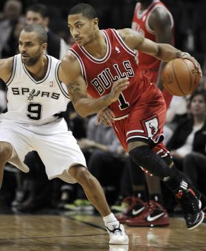Chicago Bulls' Derrick Rose, right, drives around San Antonio Spurs' Tony Parker, of France, during the first half of an NBA basketball game on Wednesday, Feb. 29, 2012, in San Antonio. (AP Photo/Darren Abate)